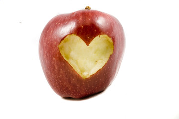 red autumn apple in heart on white background