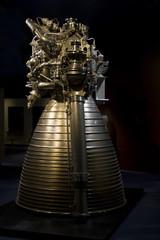 Close up shot of a rocket engine on a dark background.