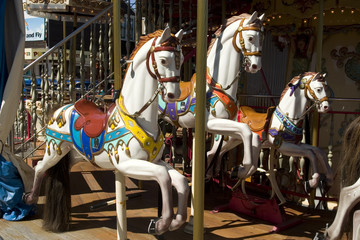 Carousel with white horse panoramic from the front