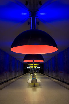 A boldly lit subway station