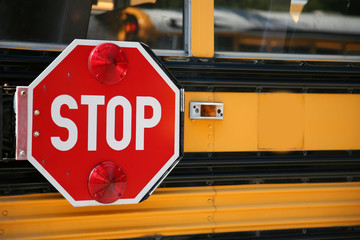 stop sign on the side os a school bus