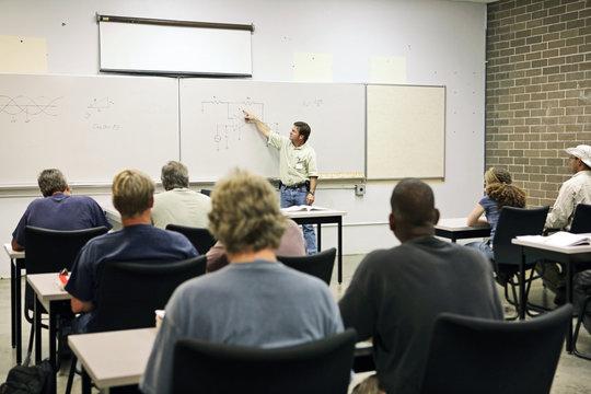 An adult education teacher