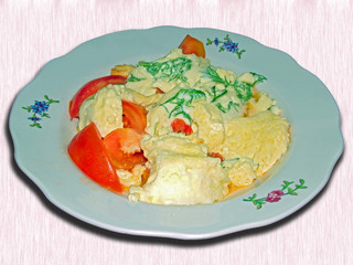 a plate with ready-to-eat omelet and tomatoes