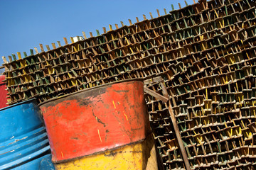 Packed pieces of rusted steel in a scrapyard.