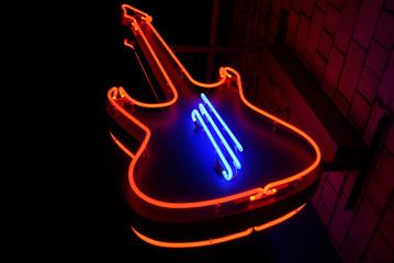 neon guitar - symbol of rock cafe