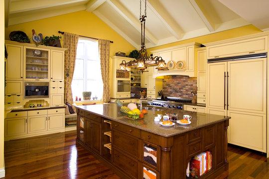 Yellow kitchen with island