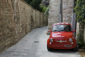 Tuinposter Oude auto s red Italian Car in old roman street