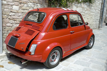 Tuinposter Oude auto s Little red Italian famous car