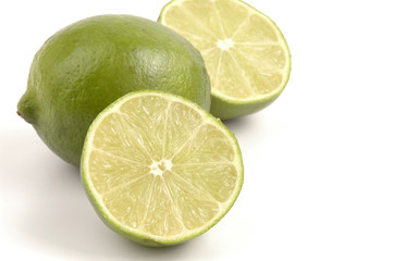 Fresh green limes isolated on a white background.