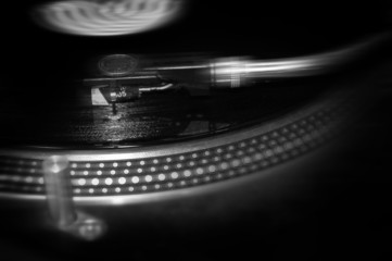 A DJ's turntable in motion.