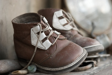 The pair of old baby shoes. Past time nostalgic concept.