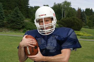 shot of a american football player wearing a helmet