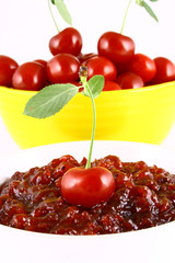 red cherry jam isolated on white -brown