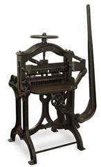 Vintage cast iron printing press, on white