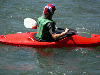 Female kayaker holding on to her paddle