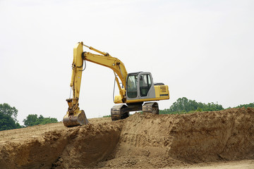 Backhoe on a Pile of Dirt