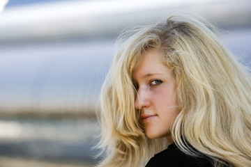 Portrait of the young woman with blond hair
