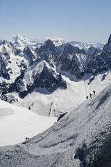 Skier on Mont Blanc mountain range viewed from Aiguille Du Midi