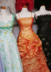 Mannequins wearing beautiful evening dresses.