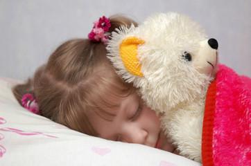 Fototapeta A little girl sleeping with a toy j obraz