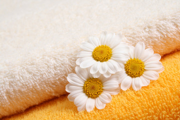 stack of towels and nice marigolds - body care