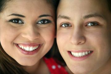 Portrait of two happy teenagers
