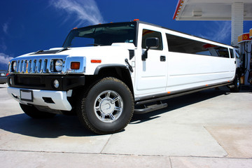 White limousine in California on gas station