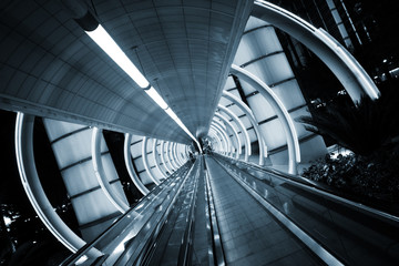 Futuristic architecture. Tunnel with moving sidewalk