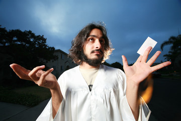 Jesus raising hands with a blank business card