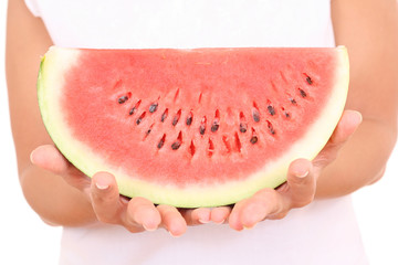 fresh watermelon in hands on white