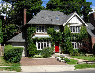 Tudor style two storey house with ivy