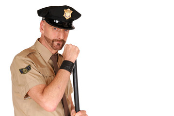 Attractive, mid fifties bearded police officer wearing kepi
