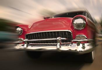 Foto op Plexiglas Oude auto s Red Car In Motion