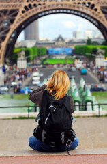 Tourist taking pictures of Eiffel tower in Paris, France.