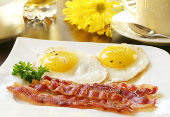 Bacon and eggs, sunny side up.
