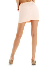 legs and back of lady in pink skirt over white
