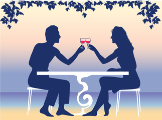 The man and the woman having supper on a resort
