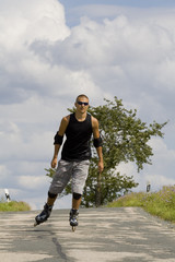 a young man on rollerblades #3