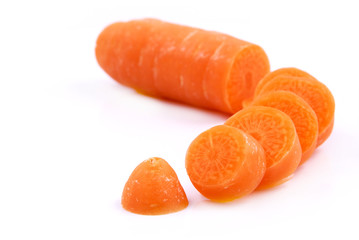 Chopped up Carrot in small slices on white background