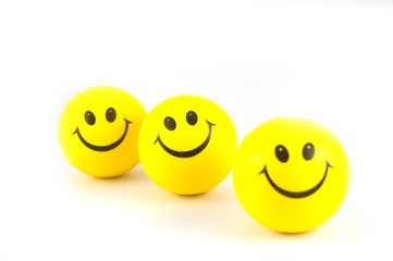 3 yellow balls with a smile