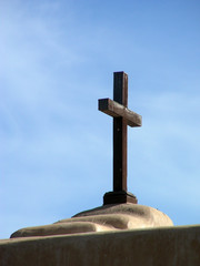 Cross atop an adobe church in the Southwestern United States