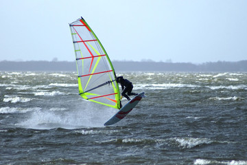 Windsurfer performing an Airjibe