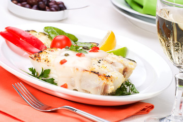 Grilled halibut with capers and pepper sauce