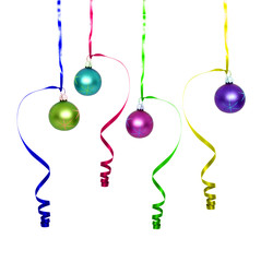 colored Christmas balls with ribbon over white background