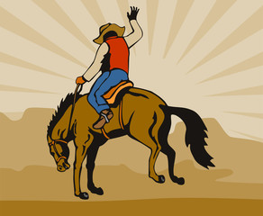 Cowboy riding a bucking bronco