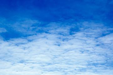 White clouds in the blue sky. Cloudscape