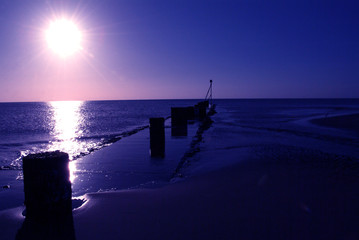 Spoed Fotobehang Pier East Coast Sun