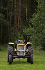tractor on edge of forest