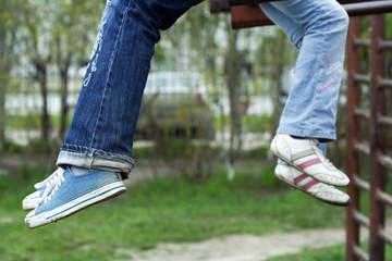 Legs of teenagers.
