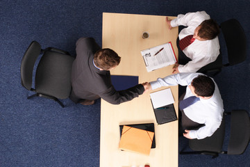 formal business handskake at the meeting
